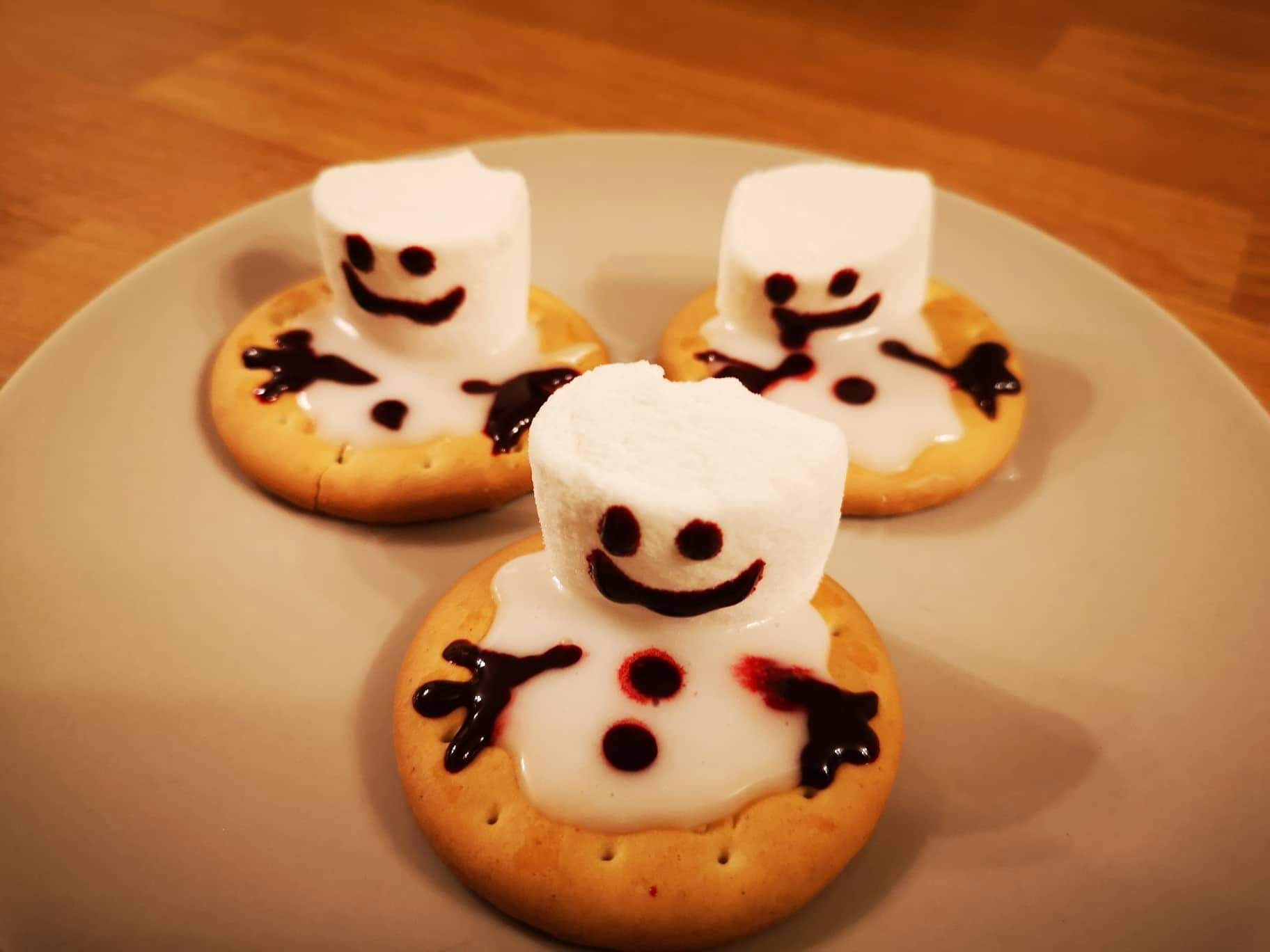 Photo of melting snowman biscuits consisting of marshmallows, rich tea biscuits and icing sugar